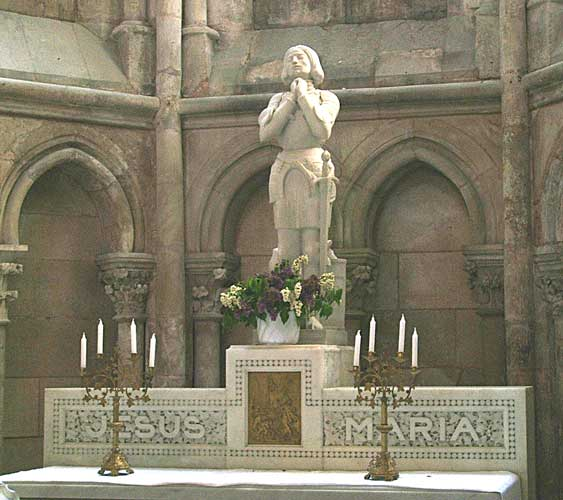 Statue of Joan of Arc in a church with words Jesus Maria