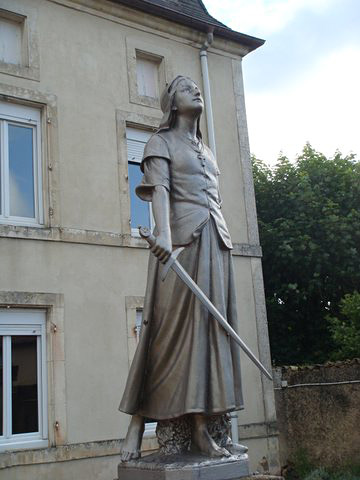 Statue of Joan of Arc leaving the Distaff for the Sword in Domremy