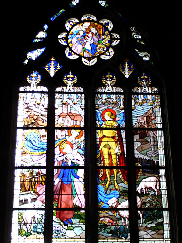 Stained Glass Window of Joan of Arc with Saints and Angels