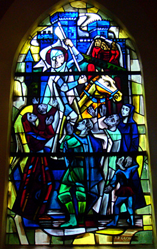 Stained Glass Window of Joan of Arc on horseback with banner