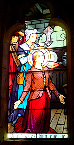 Stained Glass Window of Joan of Arc on her knees