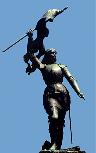 Statue of Joan of Arc with her banner held high over her head