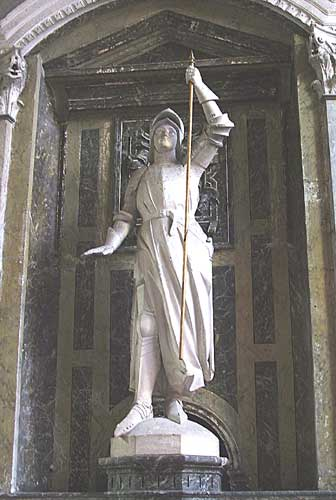 Statue of Joan of Arc Holding a Spear inside a church in France