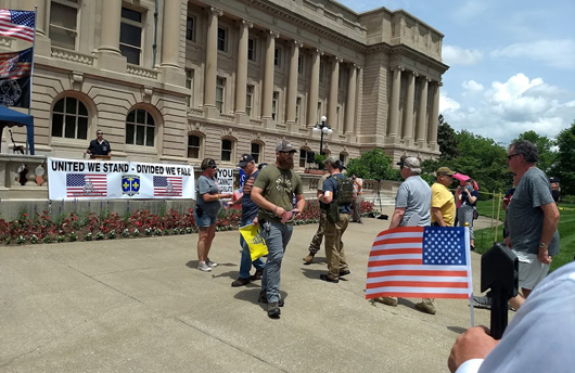 American Veterans receiving Flags